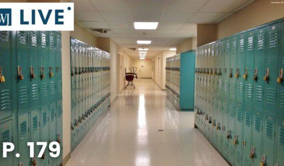 Blue lockers in a school hallway