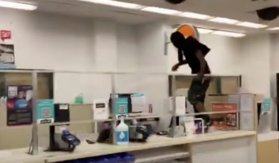 A shoplifter jumps over the counter in a San Francisco Walgreens during the height of the pandemic last October.