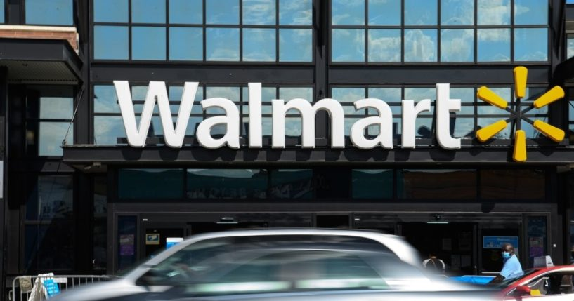Cars drive past a Walmart store in Washington, D.C., on Aug. 18, 2020.