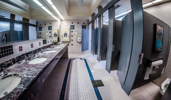 A photo of the interior of a women's restroom.