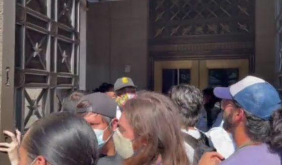 A large group of climate change protesters tried to enter the Department of the Interior on Thursday.