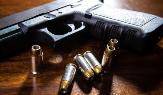 A handgun and bullets are seen in this stock image.