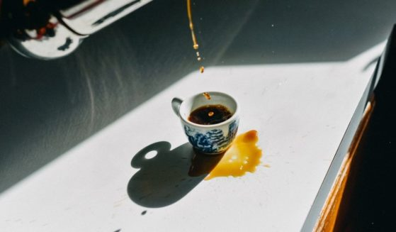 A cup of coffee being poured.
