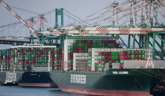 Cargo ships filled with containers dock at the Port of Los Angeles on Tuesday in Los Angeles.